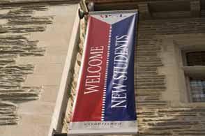 Photo of Welcome New Students banner hanging from building