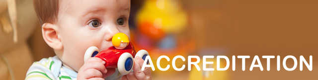 ACCREDITATION banner image - baby playing with toy