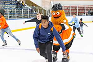 Gritty with a skater at Penn Ice Rink