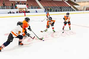 Snider Mites playing at the ice rink reopening