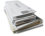 Stock photo of a stack of business reply mail envelopes
