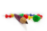 Image of a pencil surrounded by thumbtacks